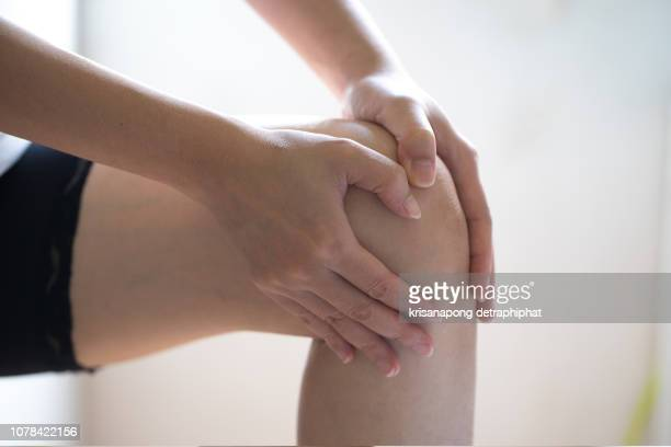 woman knee ache - osteoarthritis stock photos and pictures