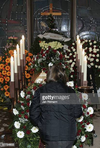 A woman kneels in front of the coffin of actress Maria Schell at the Nikolaus church on April 29 2005 in Preitenegg Austria