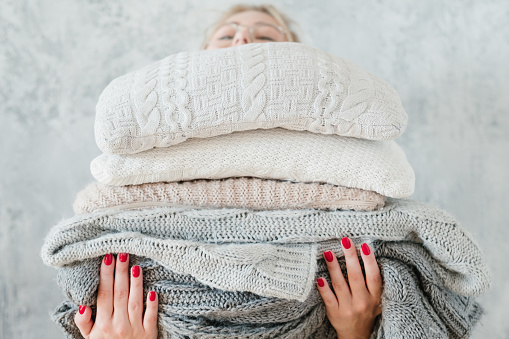 woman knitted plaid blanket cozy winter home decor 1077723854