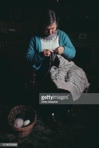 Woman knitting a Fair Isle pattern sweater, Mainland, Shetland Scotland, June 1970.