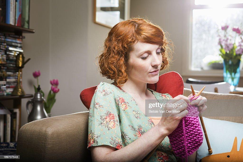Woman knitting in livingroom. : Stock Photo