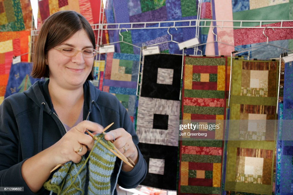 A Woman Knitting Quilts At The Farmers Market In Kerrytown Historic