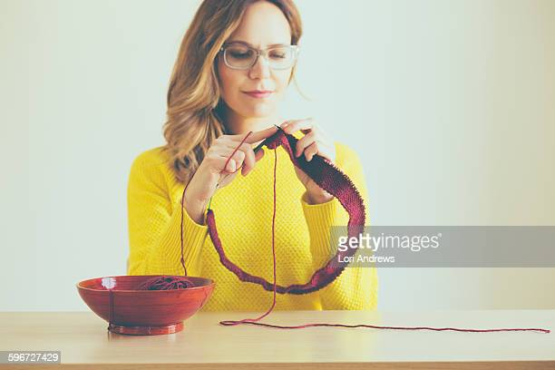 woman knitting red yarn - lori andrews stock pictures, royalty-free photos & images