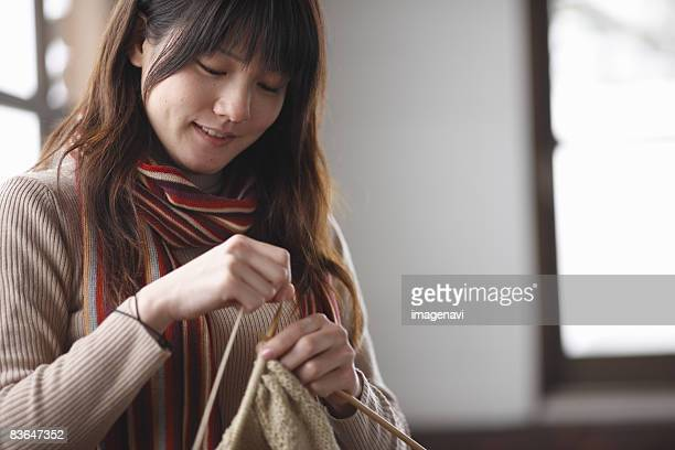 A woman knitting together
