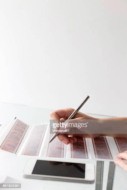 Woman labeling film strips