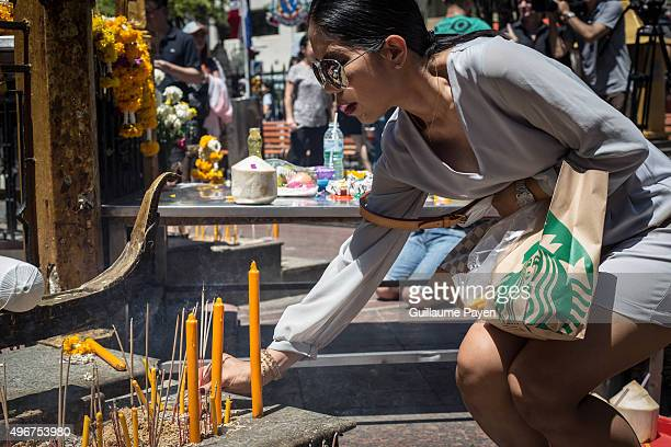Woman laid incense at the reopened Erawan Shrine in Central Bangkok on August 19th 2015, after a bomb exploded outside this shrine on August 17th,...