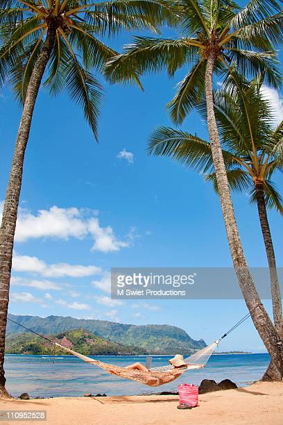 Woman laptop relaxing hammock hawaii
