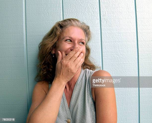 woman laughing and covering face - embrasser stock pictures, royalty-free photos & images