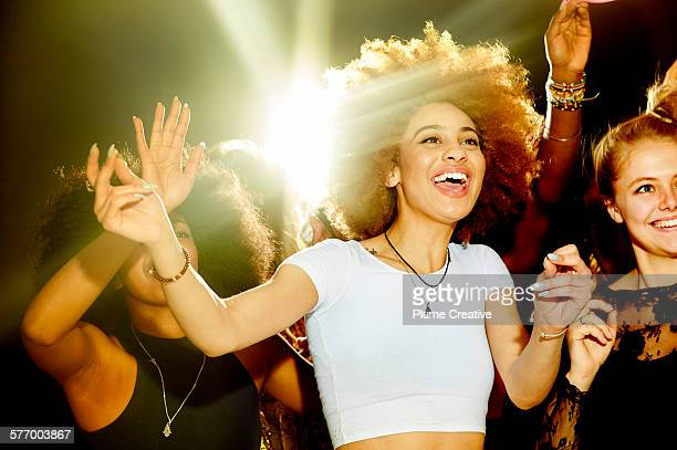 woman laughing and having fun at a party. - incidental people stock pictures, royalty-free photos & images