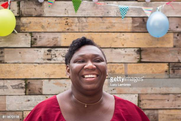 Woman laughing at a birthday party