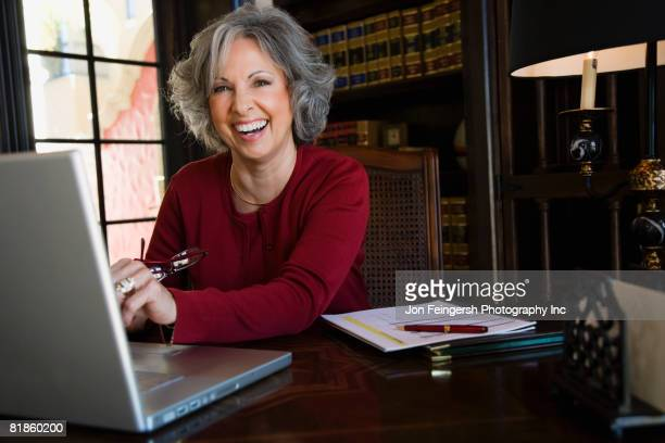 Woman laughing at desk
