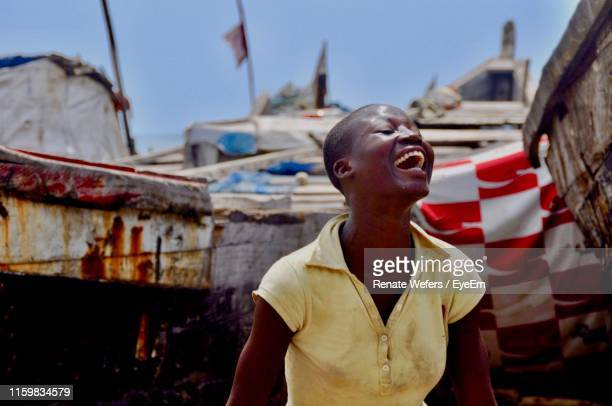woman laughing at harbor - ghana stock pictures, royalty-free photos & images