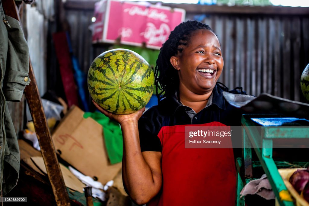 Woman laughing at her place of business