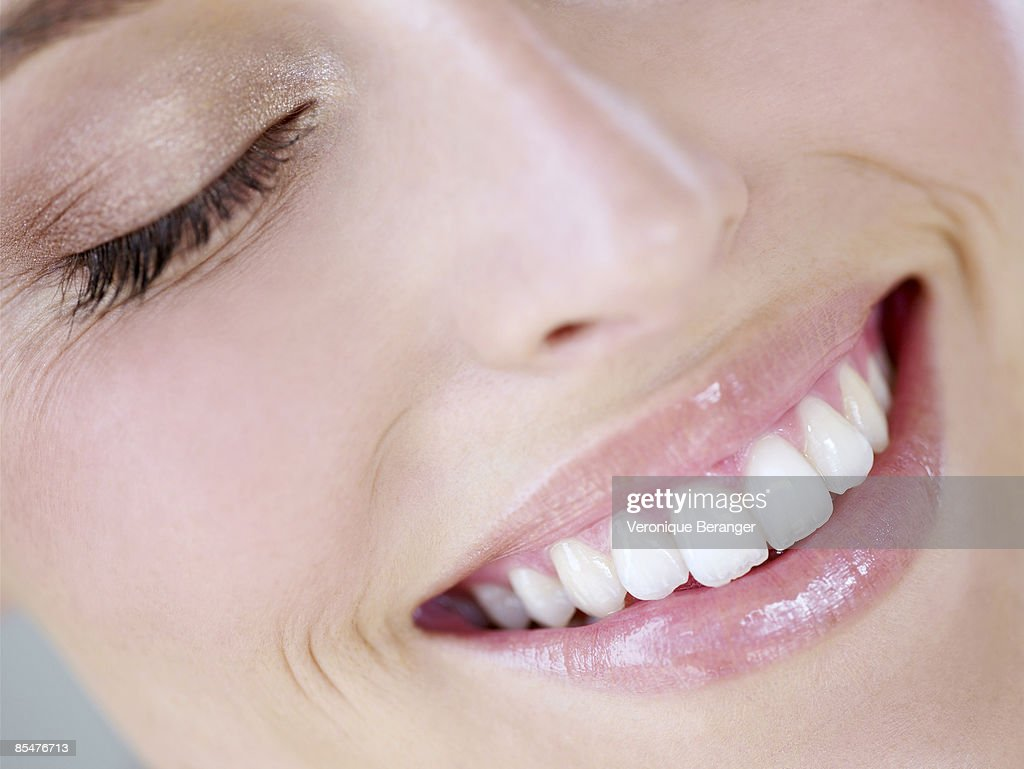 Woman laughing, close-up : Stock Photo