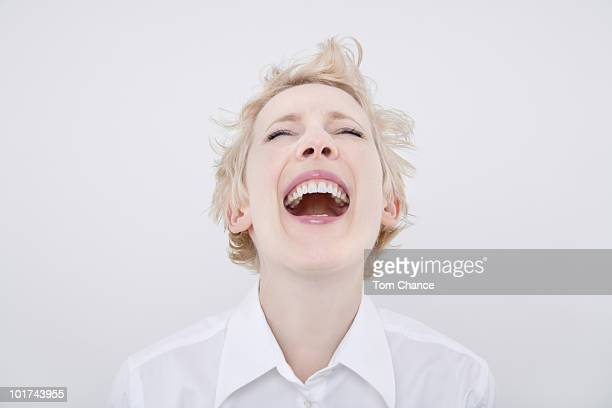 Woman laughing eyes closed, portrait