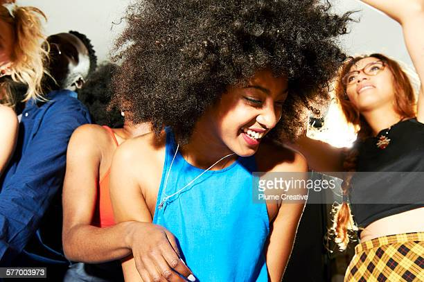woman laughing, having fun and dancing. - big hair stock photos and pictures