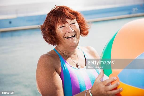 Woman laughing holding a beach ball
