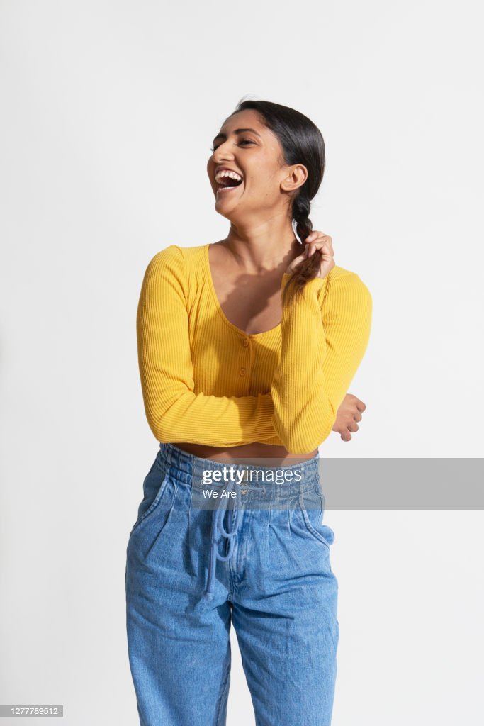 Woman laughing holding braided hair : Stock Photo
