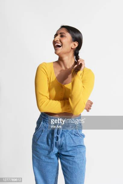woman laughing holding braided hair - one person stock pictures, royalty-free photos & images