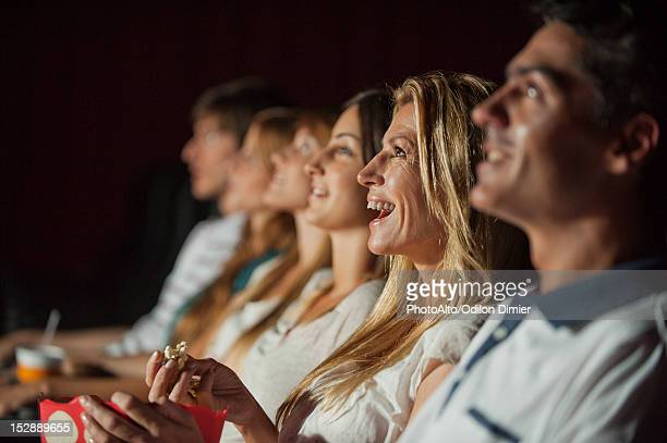 Woman laughing in movie theater