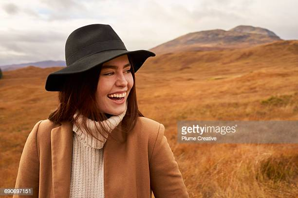 Woman laughing in the Scottish countryside