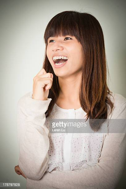 woman laughing indoors - leren stock pictures, royalty-free photos & images