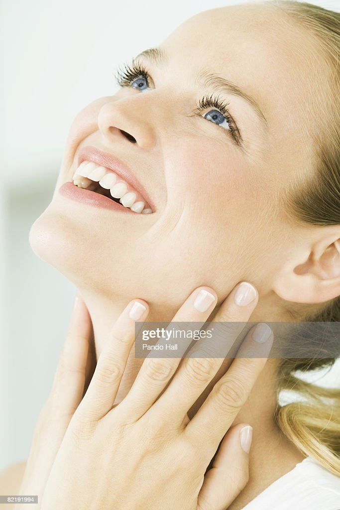 Woman laughing, looking up : Stock Photo