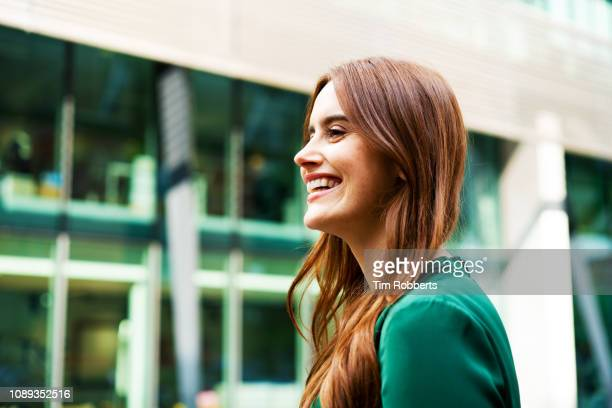 woman laughing - femme rousse photos et images de collection