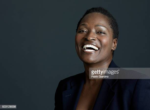 woman laughing - formal portrait stock pictures, royalty-free photos & images