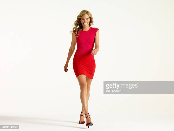 woman laughing walking forward - red dress stock photos and pictures
