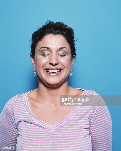 woman laughing with eyes closed, portrait - israeli ethnicity stock pictures, royalty-free photos & images