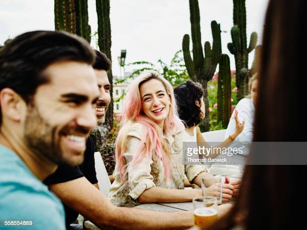 Woman laughing with friends during party