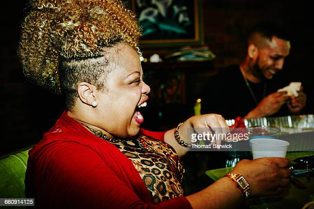 woman laughing with friends during party - fat woman funny stock photos and pictures