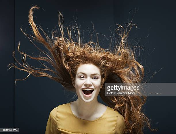 woman laughing with her hair blowing in wind. - windswept stock pictures, royalty-free photos & images