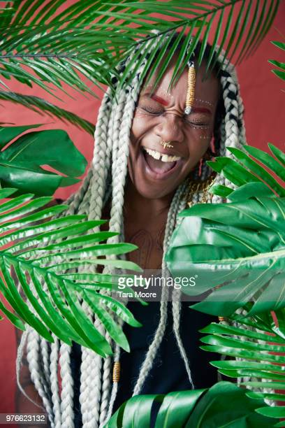 woman laughing with leaves