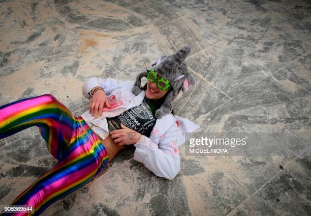 TOPSHOT A woman laughs as she takes part in the 'Domingo Fareleiro' festival in the village of Xinzo de Limia northwestern Spain on January 21 2018 /...