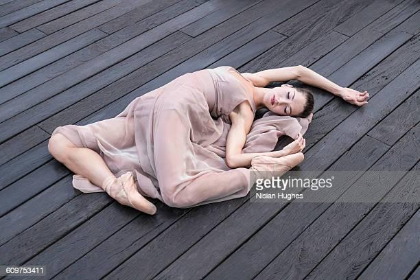 Woman laying down on wood floor nice body shape