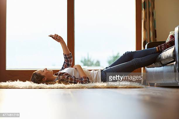 woman laying in lounge and using mobile phone. - lying down stock pictures, royalty-free photos & images