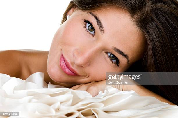 Woman laying on a silk pillow