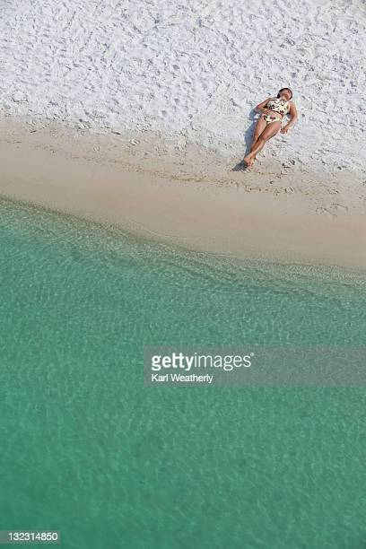 woman laying on beach - destin beach stock pictures, royalty-free photos & images