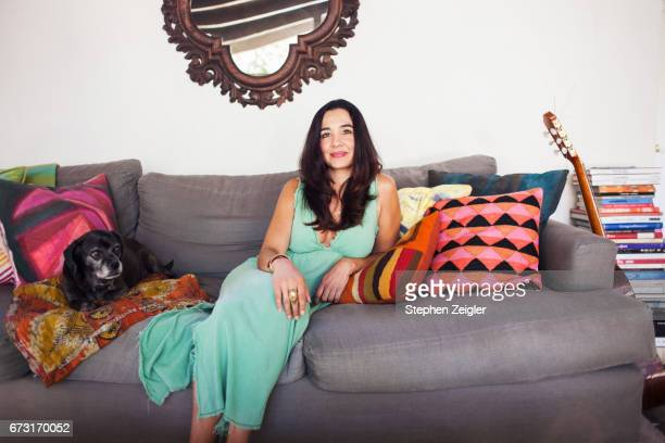 woman laying on couch - multi colored dress stock pictures, royalty-free photos & images