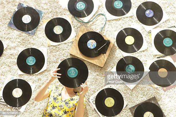 woman laying on floor looking at records