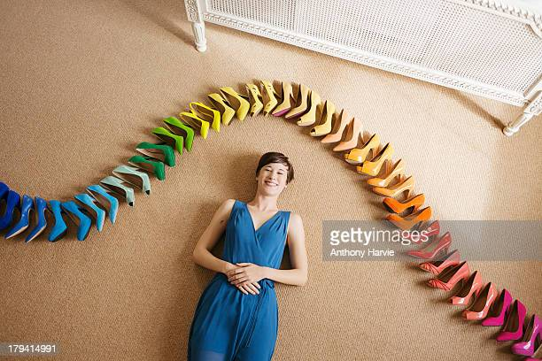 Woman laying on floor with rainbow coloured shoes