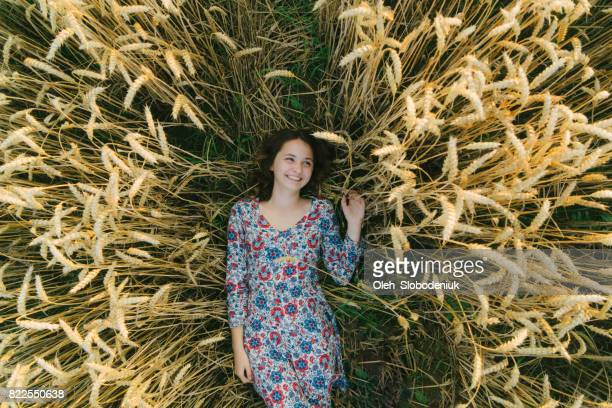 Woman laying on the  wheat field