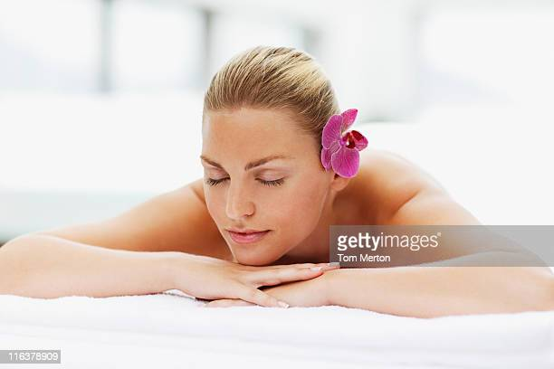 Woman laying with eyes closed on massage table