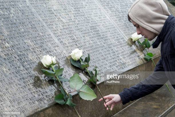 Woman lays a flower during the commemoration of the 75th anniversary of the last deportation to the Theresienstadt ghetto, a commemorative event was...