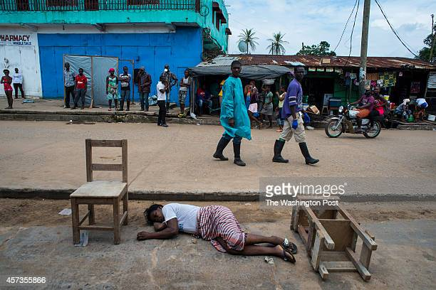 A woman lays dead outside the Redemption Hospital on Saturday September 20 2014 in Monrovia Liberia Ebola patients come to the hospital which has...