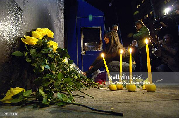 A woman lays flowers at a makeshift memorial for Imette St Guillen outside The Falls bar on Lafayette St in Manhattan The bar was the last place the...
