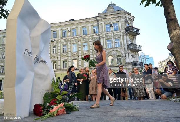 Woman lays flowers by the monument of journalist Pavel Sheremet opening on the place where his car exploded, as the colleagues and the friends...