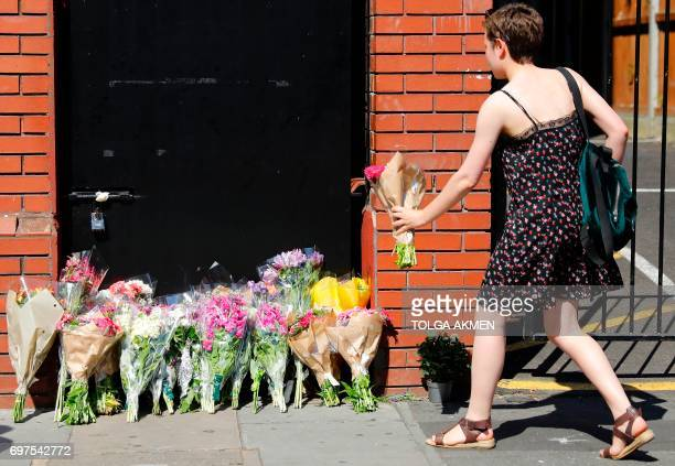 A woman lays flowers in tribute outside Finsbury Park Mosque in the Finsbury Park area of north London on June 19 near to where a vehicle was driven...